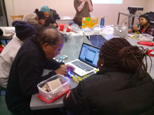 Participants at York Woods Branch learning how to light up an LED using an Arduino