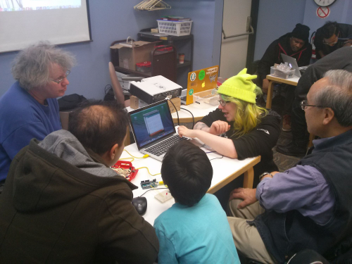Lindy introducing participants to the Arduino at Eglinton Square Branch