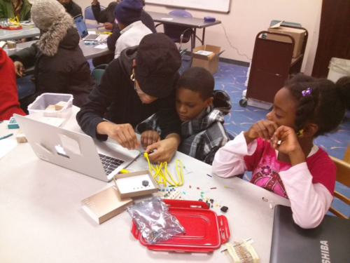 Participants of all ages learning how to program an Arduino